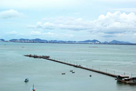 Sea with ships and the long bridge. photo