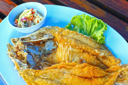 Fried fish with mango salad. photo