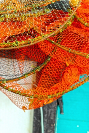 fishnet: Nets to scoop the fish are stacked.