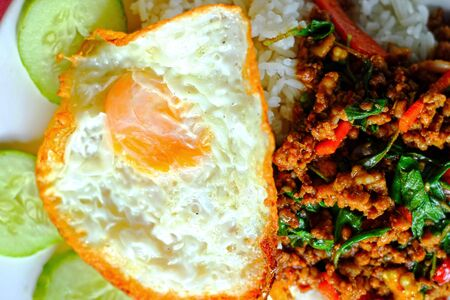rice  basil fried pork - fried egg. photo
