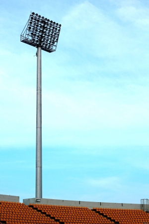 grandstand: Seat grandstand is empty stadium with a light pole.