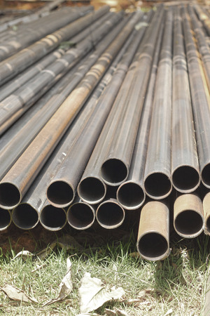 cement pole: Stack of steel pipes in industrial