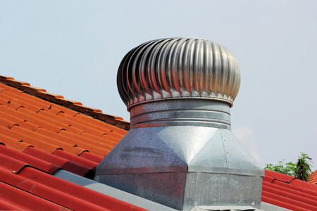 exhaust fan: stainless steel exhaust fan on roof with blue sky