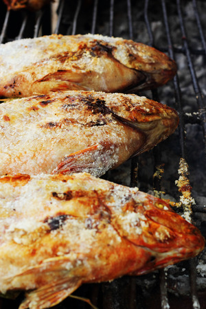 Salt fish - on the stove. Stock Photo - 22979573