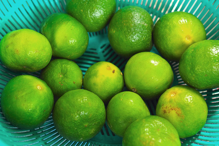 lemons fruits - green fruit in the basket  photo