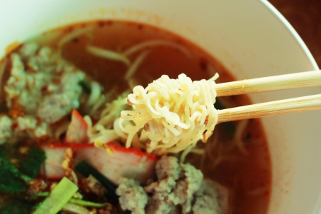 Pork noodles in soup asian style photo