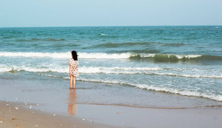 looked: The girl looked at the sea beach. Stock Photo