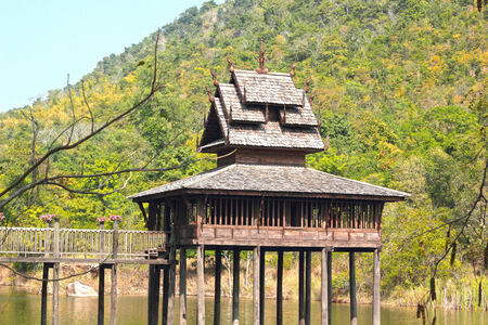 Thai Wooden House in the river photo