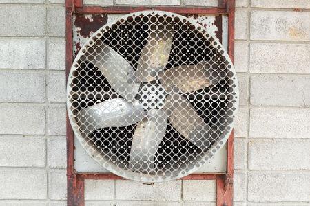 Industrial fan in the rear wall.