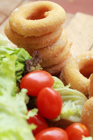 donut and sugar - fresh vegetable salad. photo