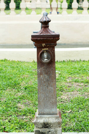 Antique faucets in the park photo