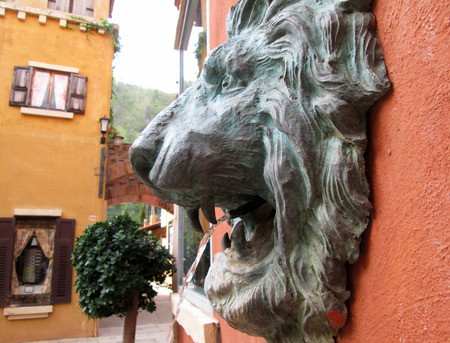 spitting: lion statue  spitting water - vintage style