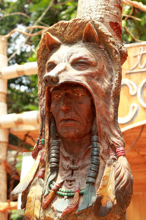 old wood carved of indian chief head
