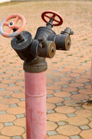 red rusty metal industrial water pipes with a valve. Stock Photo