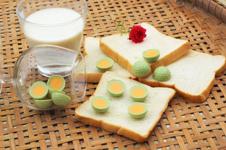 fresh milk and bread plate with chocolate green. Stock Photo