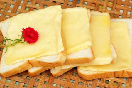 cheese the place on a slice of bread. photo