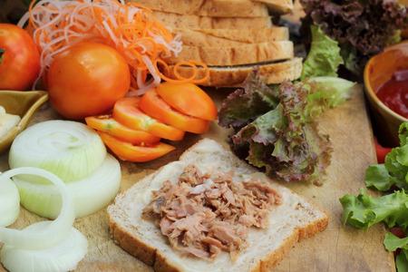 making tuna sandwich with fresh vegetables photo