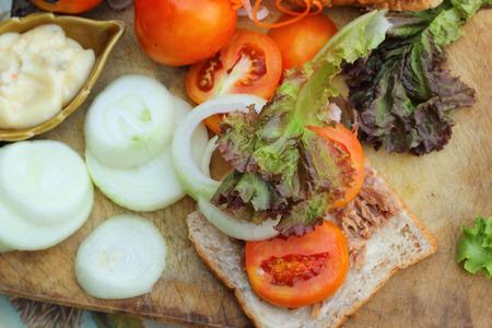 making a sandwich: making tuna sandwich with fresh vegetables