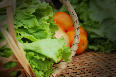 Vegetables salad and tomato in the basket photo