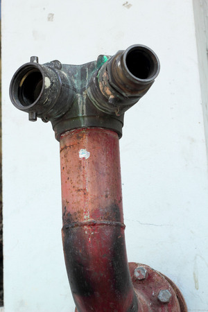 'main squeeze': Fire hose river - old red Stock Photo