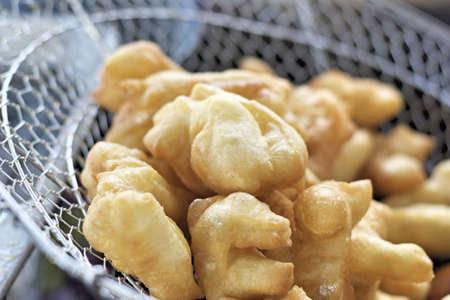 Deep-fried dough stick in market photo
