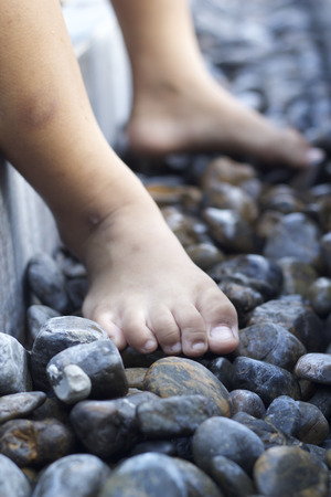 bare feet: Bare feet on rocky ground