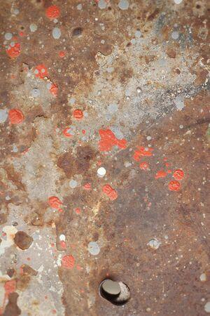paint background: De metal de color oxidado con el fondo la pintura agrietada Foto de archivo