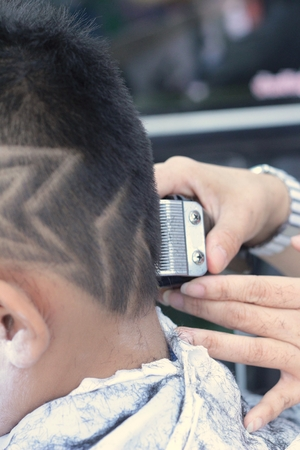 The Boys Haircut With Clipper And Razor In The Barber Shop Stock - Boy haircut razor