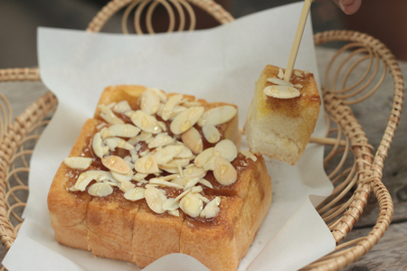 topped: Toast topped with almonds and honey. Stock Photo