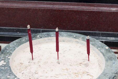 worship service: joss stick pot sculpture in the temple