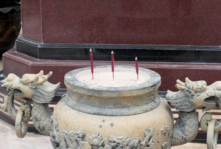 worship service: joss stick pot with dragon sculpture in the temple