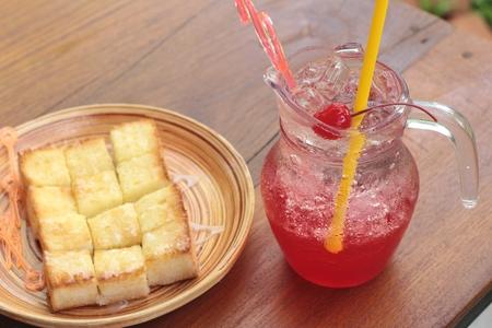 bread soda: Red beverage mix soda and bread toast. Stock Photo