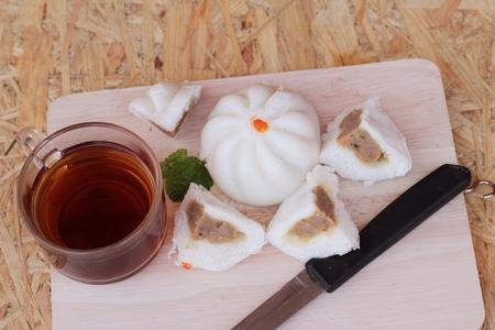 steamed pork buns, chinese dim sum and hot tea photo