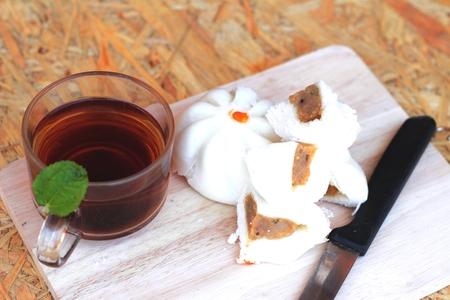 steamed pork buns chinese dim sum and hot tea photo