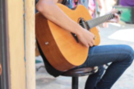 guitar player: blureed men playing the guitar Stock Photo