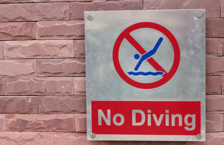 forbade: Prohibition sign jump off into the pool on the floor Stock Photo