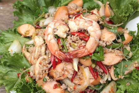 green leafy vegetables: Spicy seafood noodle with green leafy vegetables.