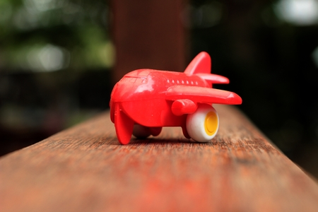 Toy plane with a red propeller. photo