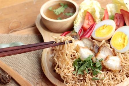 noodles soup: Instant noodles soup put crispy pork and egg Stock Photo