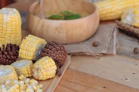 condensed: Corn soup of condensed in a wooden bowl