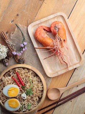 noodles soup: Instant noodles soup put egg and shrimp Stock Photo
