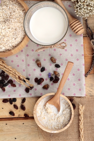 Oat flakes with currant dried fruit and milk Stock Photo - 42578941