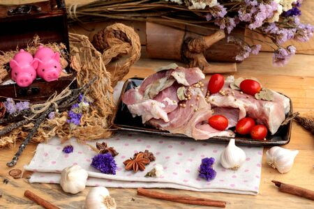 meat alternatives: Raw pork for cooking with garlic and pepper Stock Photo