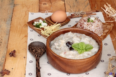 bowl with rice: Brown rice porridge put pork and brown rice with soft-boiled egg Stock Photo