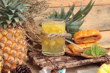 fruits juice: Pineapple juice and fresh pineapple with bread baked with pineapple Stock Photo