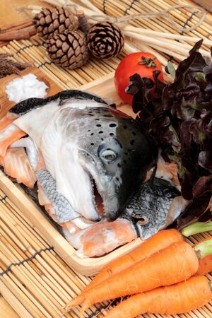 salt and pepper: Salmon head and salt , pepper for cooking Stock Photo