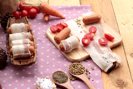 bacon fat: Sausages  wrapped in raw bacon fat at delicious