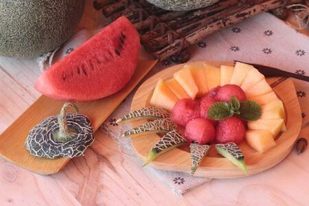 globose fruits: Orange cantaloupe melon fruit juicy on wood background