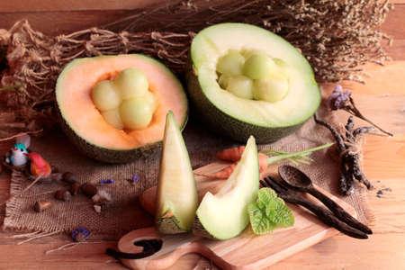 juicy: Cantaloupe melon fruit juicy on wood background