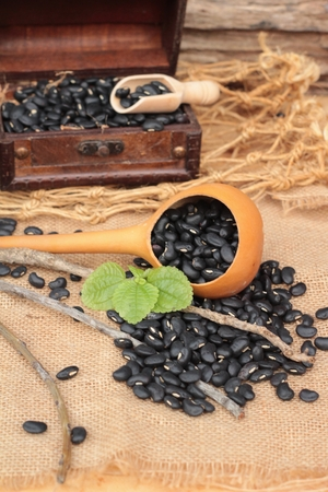 black beans: Dried black beans on wood background